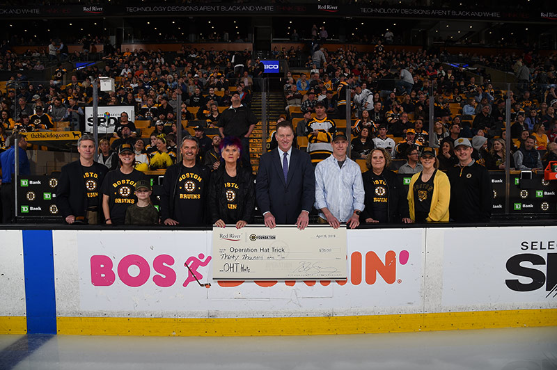 2019 OHT Check Presentation - Photo of people holding giant check