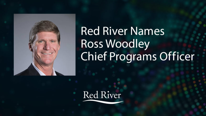 Ross Woodley headshot with white sans-serif text over dark blue technology background
