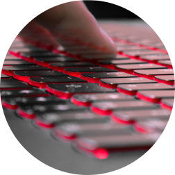 Think Red Index Hero - Person typing on a keyboard with red under lighting